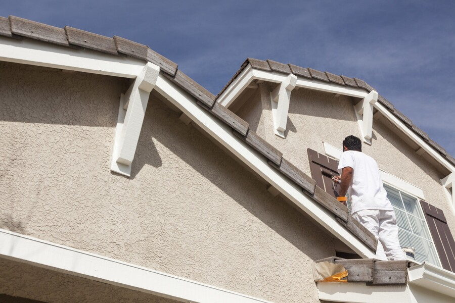 Exterior Painting being performed by an experienced Fresh Coat Painters painter.